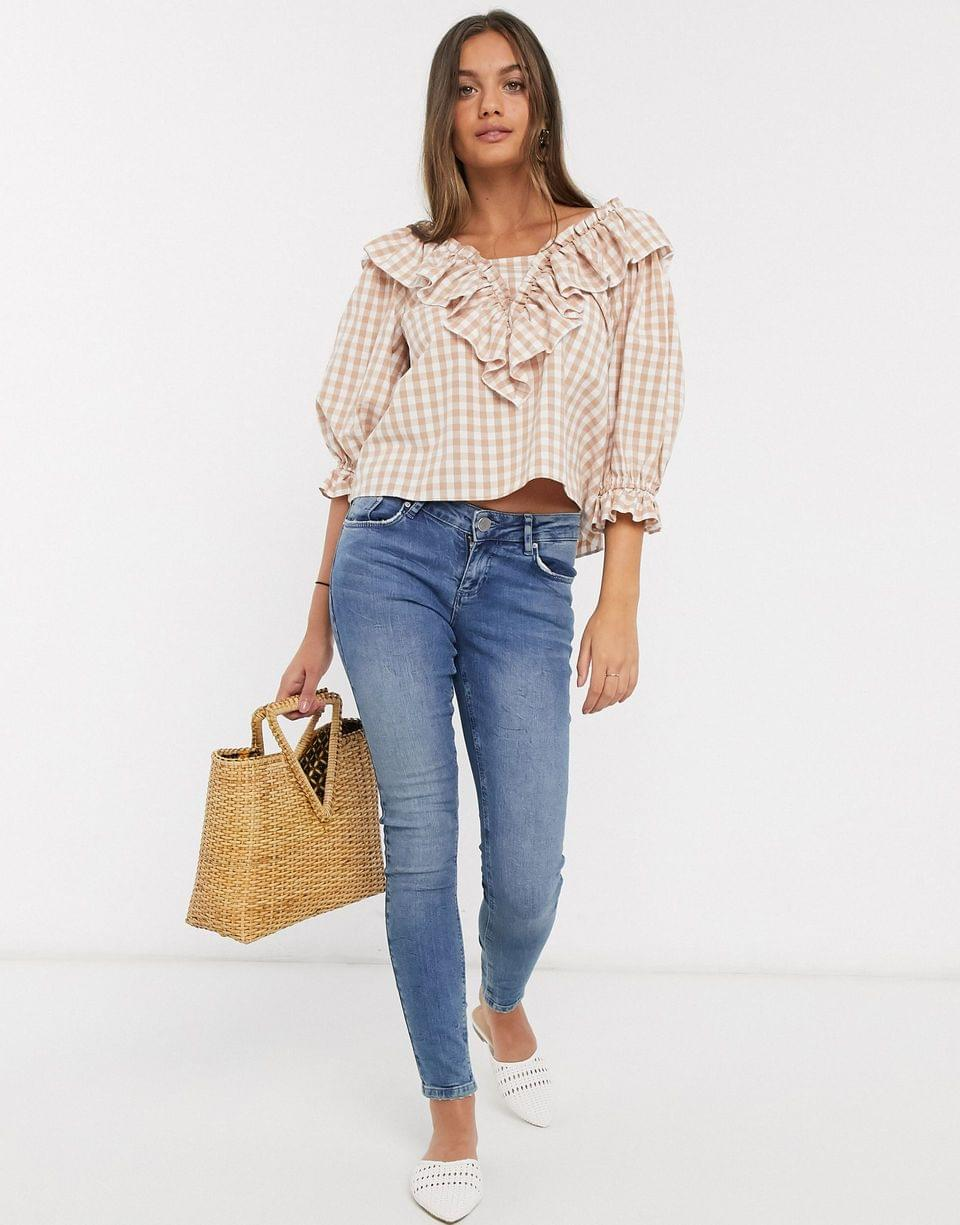 Women's Petite long sleeve gingham top with ruffle detail
