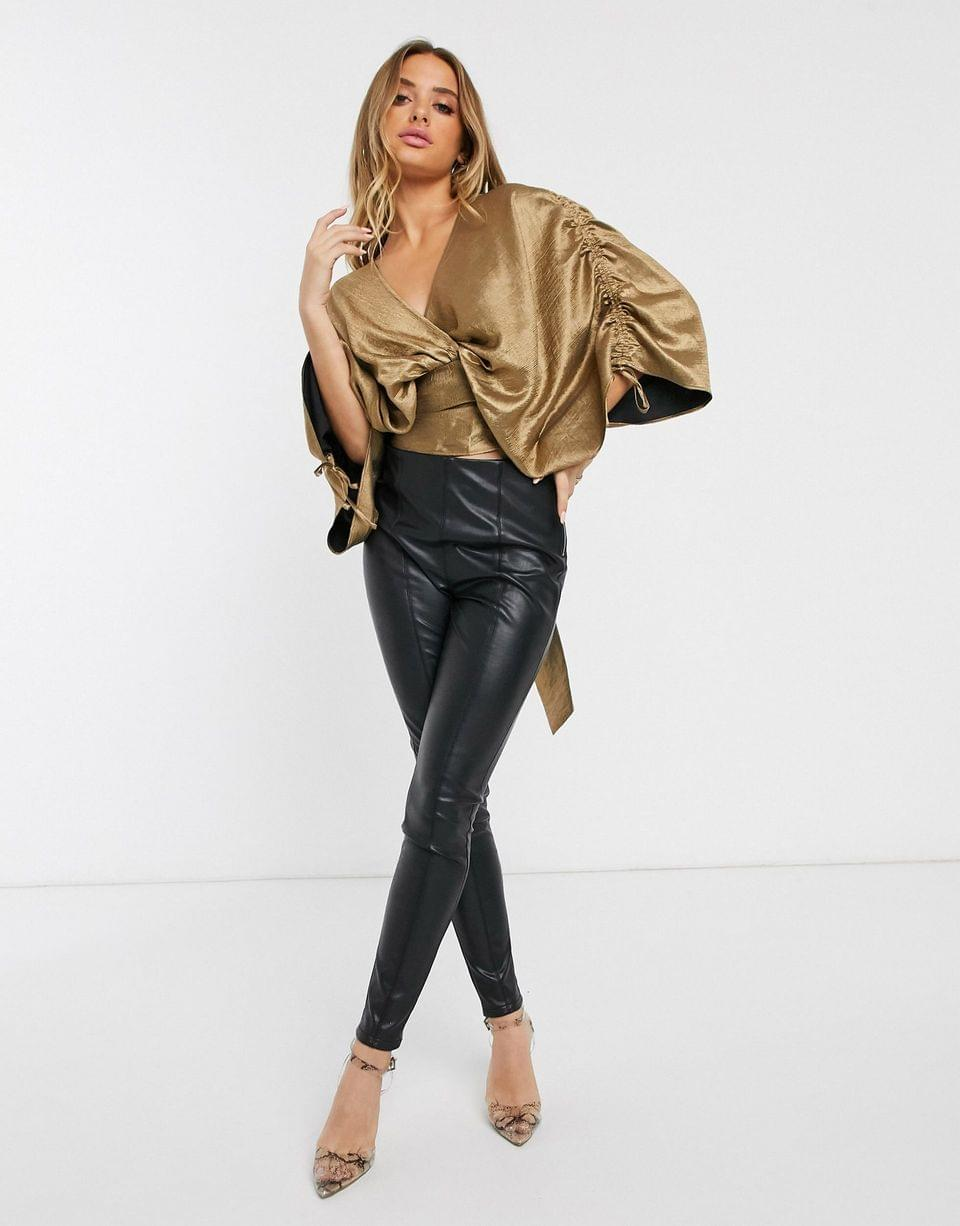 Women's long sleeve satin top with ruched detail