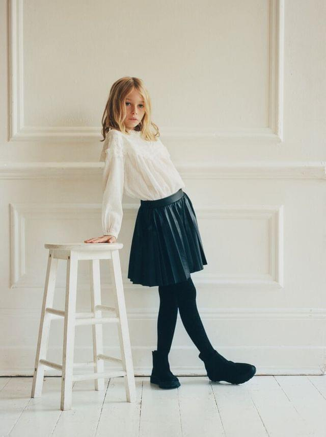 KIDS FAUX LEATHER PLEATED SKIRT