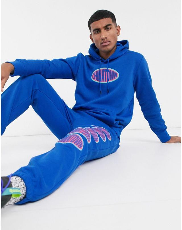 Chinatown Market Oval chest logo hoodie in blue