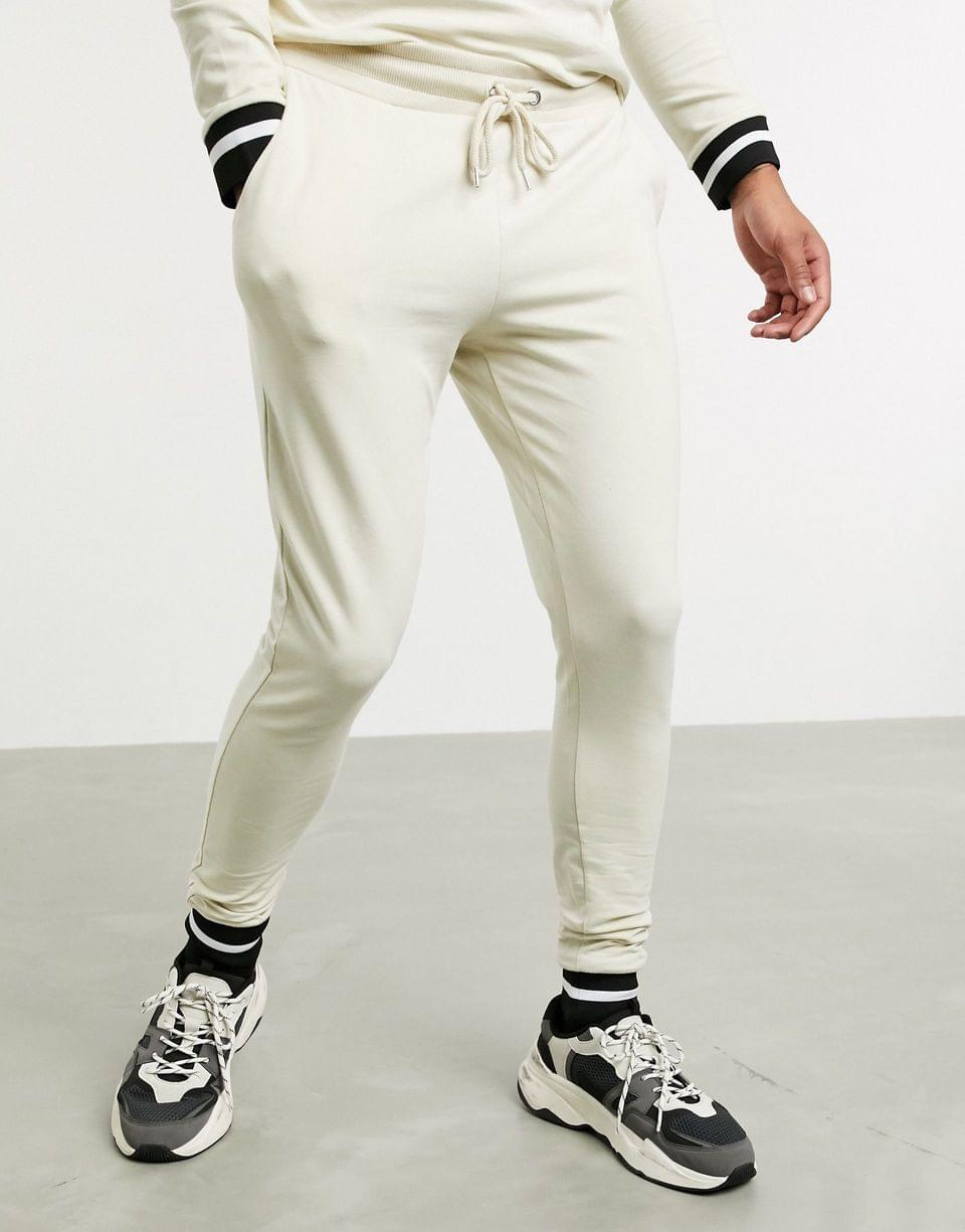 muscle tracksuit with striped rib in beige