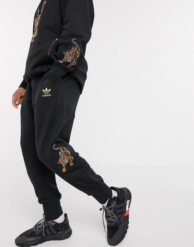MEN adidas Originals chinese new year sweatpants with tiger print in black