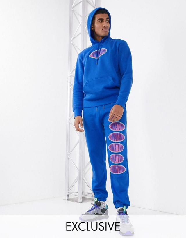 Chinatown Market Oval chest logo sweatsuit in blue