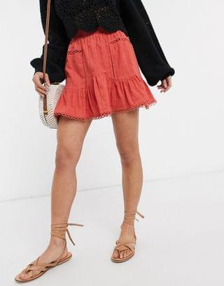 Women's Petite textured dobby mini skirt with ruffle and lace insert in red