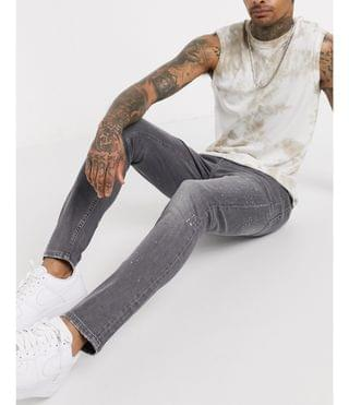 MEN New Look super skinny jeans with paint splat in washed gray