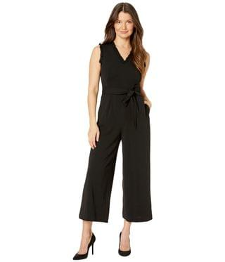 Women's Belted Ruffle Neck and Arm Jumpsuit. By Calvin Klein. 85.35. Style Black.