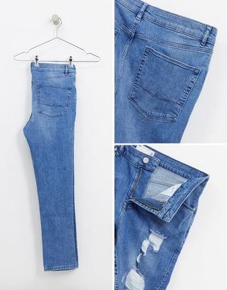 cropped super skinny jeans in light wash blue with extreme heavy rips