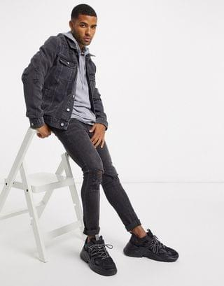 denim jacket in washed black with rips