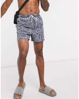swim shorts in navy with abstract print and acid wash short length