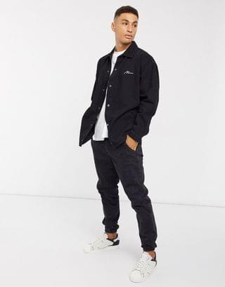 boohooMAN man script denim overshirt in black