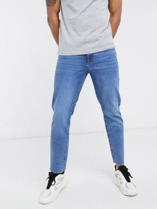 classic rigid jeans in sustainable dark wash blue with raw hem