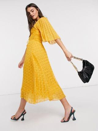 WOMEN dobby midi dress with lace up and fluted sleeves in mustard