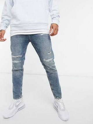Pull&Bear carrot fit jeans with soft rips in mid blue