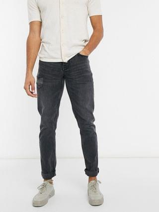Tall slim jeans in washed black with abrasions