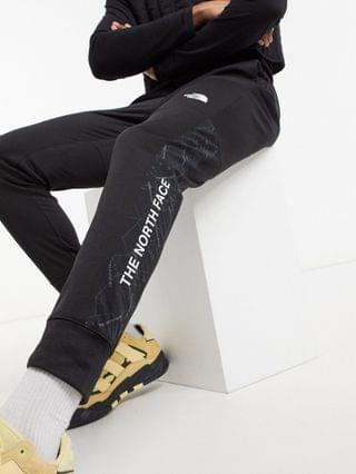 The North Face Train N Logo cuffed pants in black