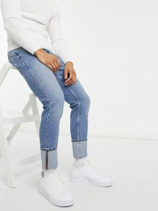 stretch slim jeans in mid wash blue with deep cuff