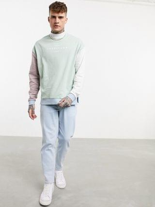 oversized turtle neck sweatshirt in pastel color block with chest print
