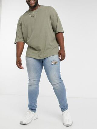 Plus skinny jeans in vintage light wash blue with thigh rip