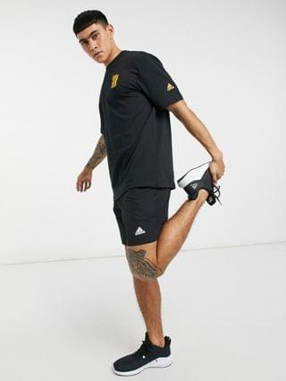 adidas Training urban back print T-shirt in black and gold