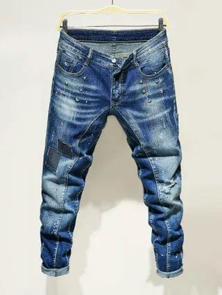 MEN Star Patched Ripped Tapered Jeans