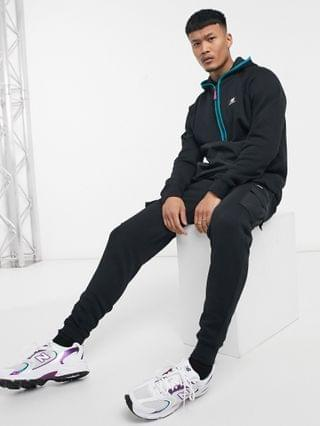 New Balance terrain hoodie in black with mesh pockets