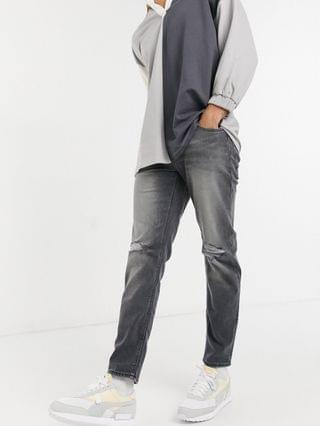 MEN tapered jeans with 'less thirsty' wash in black with knee rips