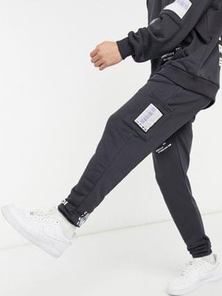MEN The Couture Club relaxed printed sweatsuit set in charcoal