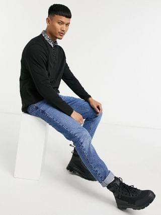 relaxed long sleeve polo with contrast collar in black