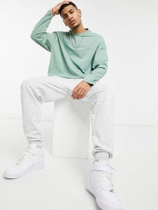Unrvlld Supply oversized long sleeve t-shirt in sage green with chest embroidery