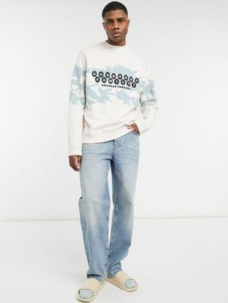 Crooked Tongues sweatshirt with blue wash and goodfeel family print
