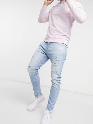 Bershka premium super skinny fit jeans with rips in blue