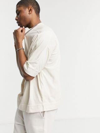 oversized t-shirt with chunky hem and seam detail in washed beige
