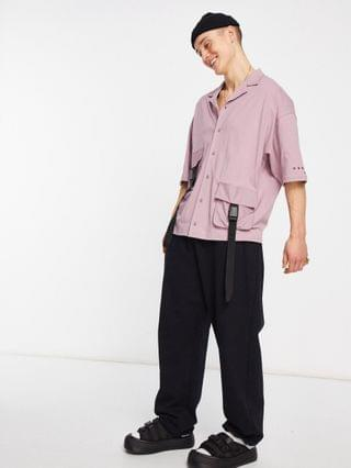 Unrvlld Supply button through jersey shirt with utility pockets & strapping detail with logo sleeve print