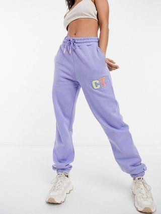 WOMEN Crooked tongues oversized sweatshirt and sweatpants set with varsity motif in washed
