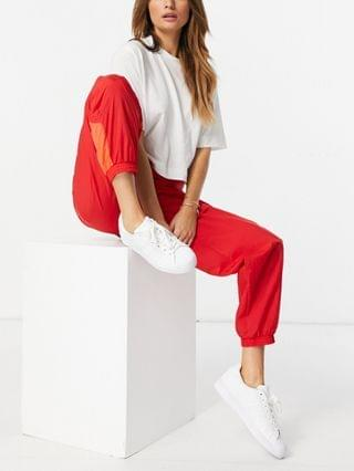 WOMEN adidas Originals spliced hem sweatpants in red