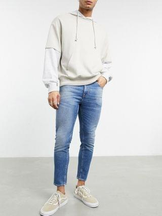 cropped skinny jeans in vintage mid wash with abrasions