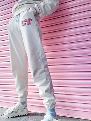 WOMEN Crooked tongues sweatpants with badge logo in ecru - part of a set