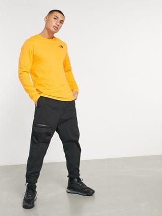 The North Face Faces long sleeve T-shirt in orange Exclusive to