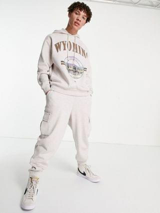 oversized sweatpants with cargo pockets in beige heather - part of a set