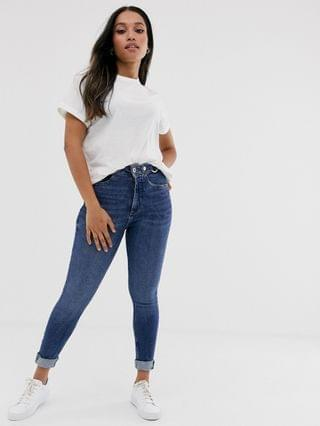 WOMEN River Island Petite skinny jeans with rips in mid wash