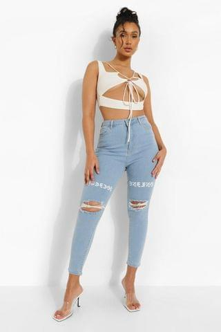 WOMEN Distressed Skinny Jeans With Thigh Print