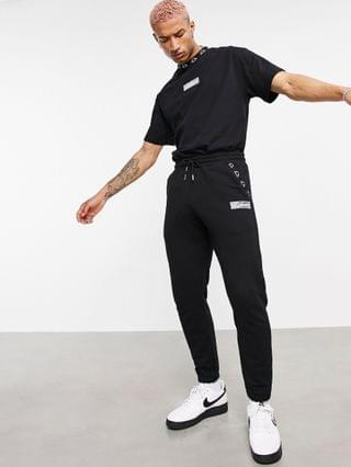 The Couture Club x Ellesse logo tracksuit set in black