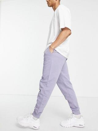 tapered sweatpants with pin tuck in purple