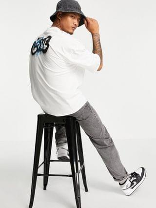 oversized t-shirt in white with graffiti back print