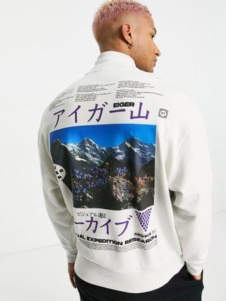oversized turtle neck sweatshirt with large mountain back graphic and embroidery neck detail
