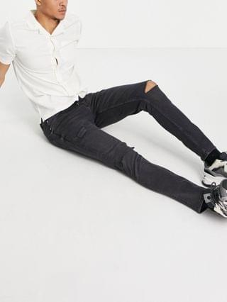 MEN skinny jeans in washed black with knee rips