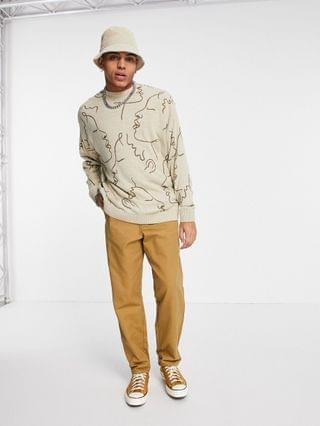 knitted sweater with handrawn design in beige