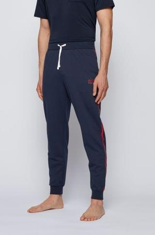 MEN Tracksuit bottoms in cotton with contrast tape and logo
