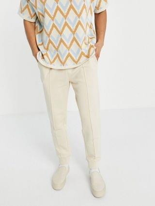 tapered sweatpants with pin tuck in beige