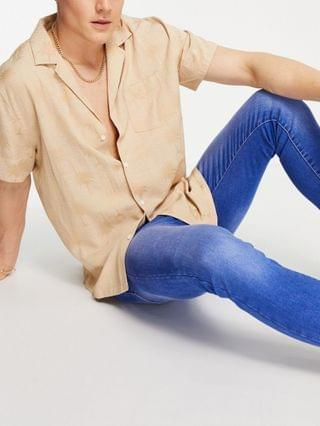 MEN New Look super skinny jeans in bright blue wash